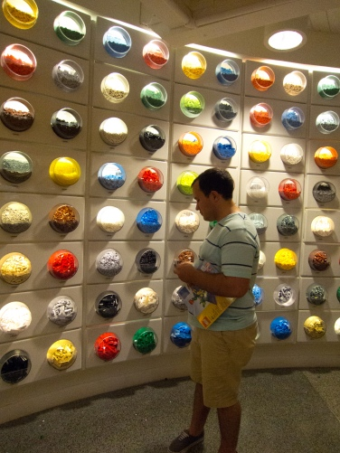 Cason with the wall of legos